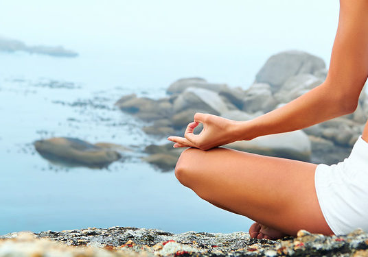 yoga-girl-meditating-easy-pose-on-the-beach-web-header